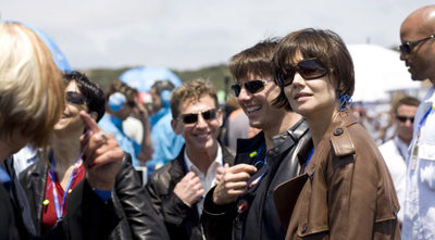 David Miscavige (center) parties with buddy Tom Cruise at a motorcycle race.