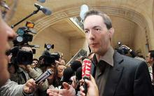 Eric Roux, head of the Paris Celebrity Centre of Scientology, answers questions at the court house.  Photo: AFP/GETTY