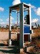 Image of a pay phone in the desert
