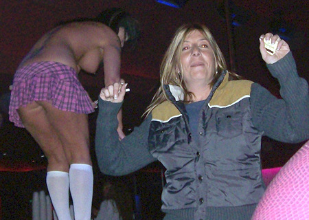Photo of Yael Lustgarten dancing with a stripper, December 2007